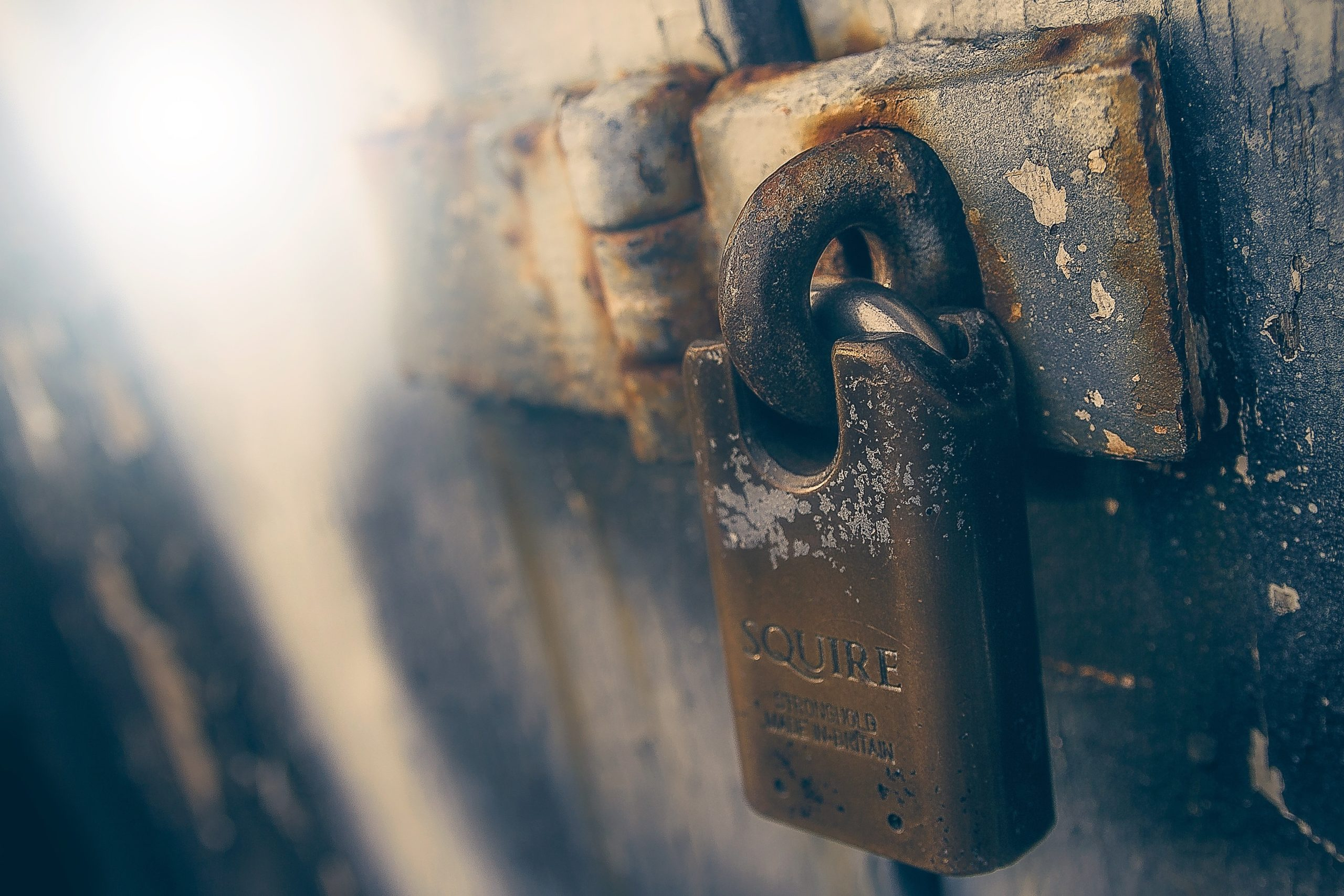 old door secured with a rusty padlock